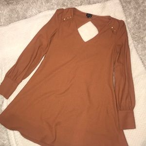 This is a cinnamon long sleeve short dress.